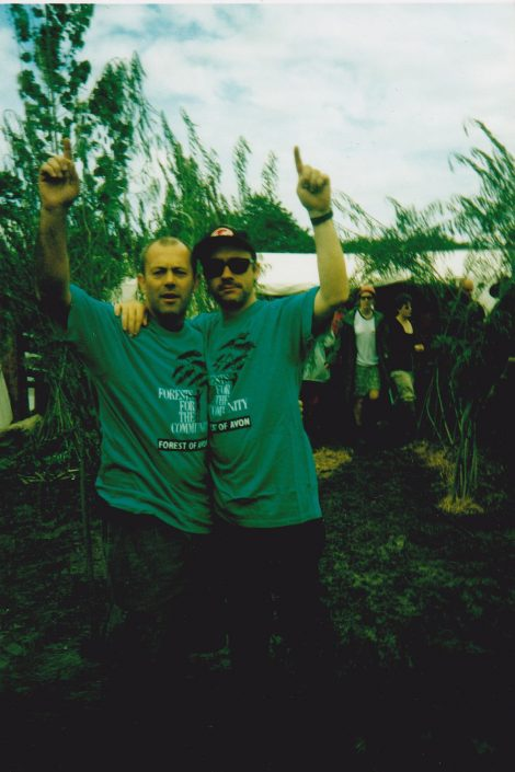 Keith Allen and Damien Hirst selling trees from dans future for a stand at Glastonbury festival.